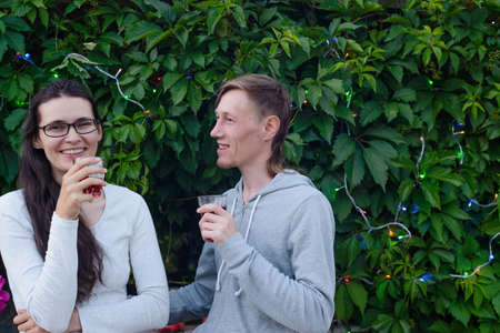 happy couple drinking wine outdoors with copy space Stock Photo