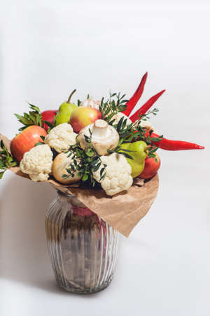 autumn bouquet of fresh fruits, vegetables and mushrooms as concept of accumulate vitamins for the winter