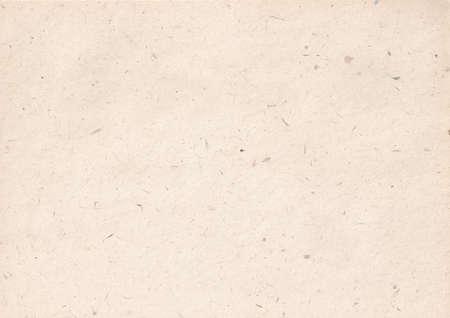 texture of light kraft paper sheet with soft dark brown grain shavings Stock fotó