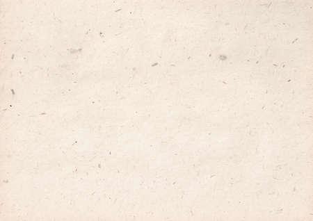texture of light kraft paper sheet with soft dark brown grain shavings Stock Photo