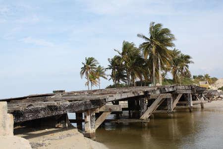 forgotten: Old wooden and broken bridge, in Guanabo beach, Cuba