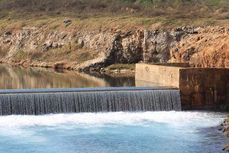 dike: Waterfall in a reservoirs dike