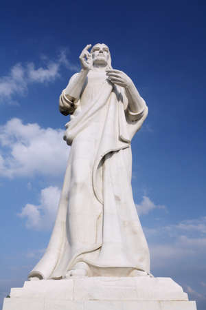 Jesus Christ statue against a blue sky in Havana, Cuba photo