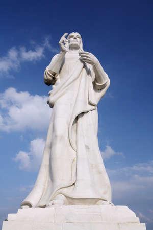 Jesus Christ statue against a blue sky in Havana, Cuba photo