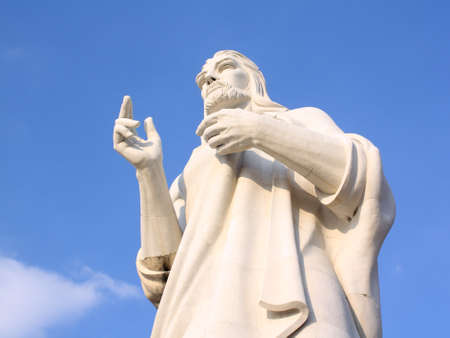 Jesus Christ statue closeup against a blue sky in Havana, Cuba photo