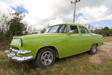 Old green american car stopped in the grass, in Cuba Stock Photo - 4667512