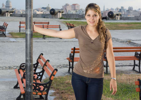angelical: Girl standing beside an iron column in a park Stock Photo