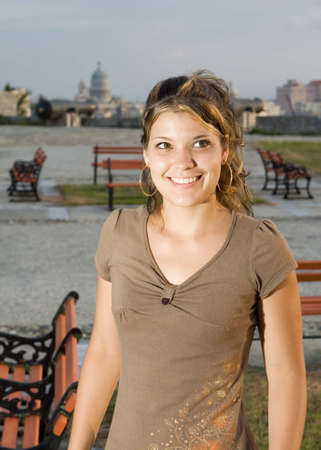angelical: Girl smiling in a park, with Havana City background, Cuba