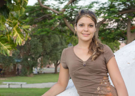 angelical: Girl smiling with a park in the background