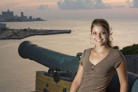 angelical: Havana City sunset with a beautiful girl and an old cannon Stock Photo