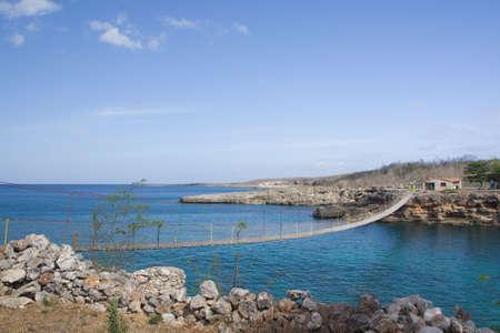 Wooden bridge on a rocky seashore, in Cienfuegos, Cuba photo