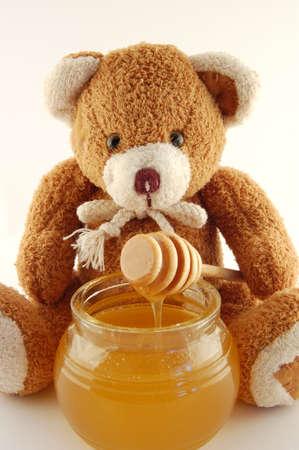 Osito de peluche con miel  Foto de archivo - 1374306