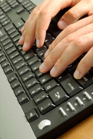 compute: Hands on keyboard Stock Photo