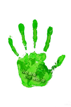 Hand print green color on world map with text we are the world photo