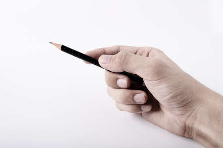 Hand with pencil photo