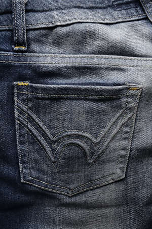Close up of a blue jeans pocket photo