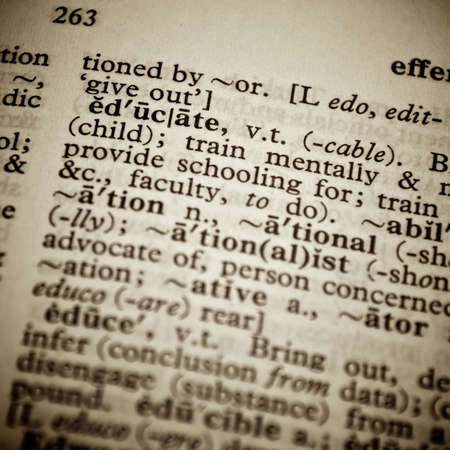 pronounce: Close up of the word educate from a dictionary
