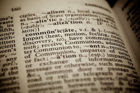 Selective focus on the word communicate.