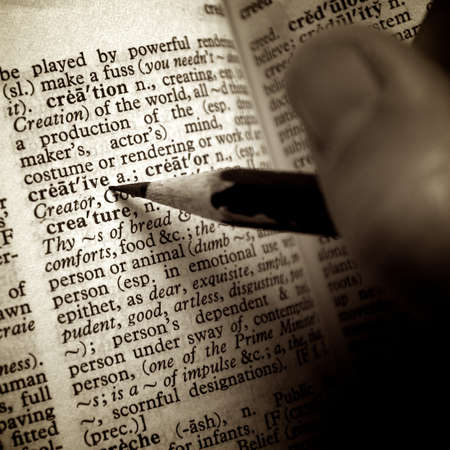 definition define: Creative definition pointed out by pencil in old dictionary Stock Photo