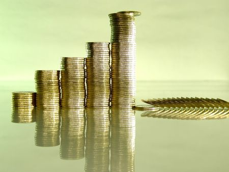 Diagram consisting of piles of coins, denotes financial collapse Stock Photo - 4440207