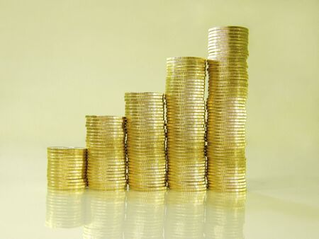 financial growth: diagram consisting of piles of coins indicating the financial growth Stock Photo