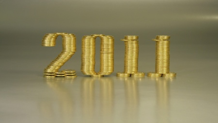 two thousand eleven years folded of the stacks of coins Stock Photo - 8431372
