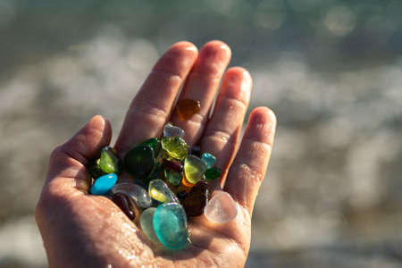 Colorful pieces of sea glass in a hand