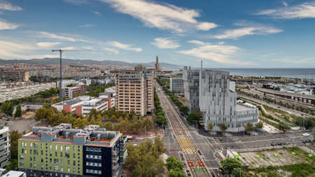 Aerial view of Forum area, Diagonal Mar district, sea, port and avenue of Eduard Maristany in Barcelona, Spain.