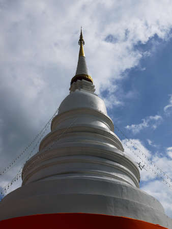 eminent: The white pagoda with cloudy sky.