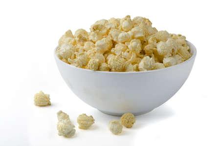 Popcorn in ceramic bowl  isolated in white background
