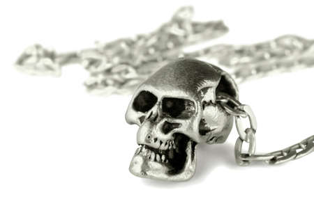 Silver  skull pendant on a chain on a white background