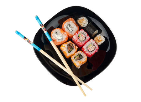 Sushi with chopsticks on a plate on a white background
