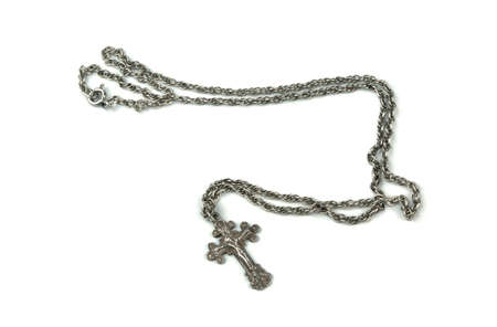 Orthodox crucifix and chain on a white  bakground