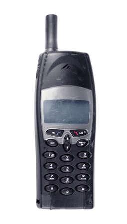 scarring: Usato vecchio telefono cellulare su uno sfondo bianco Archivio Fotografico