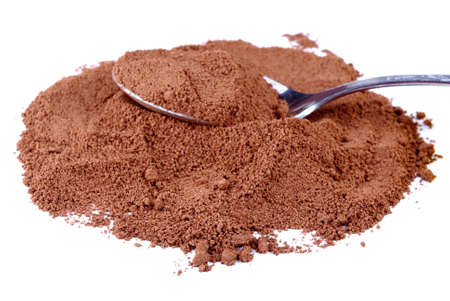Cocoa powder with a spoon on a white background