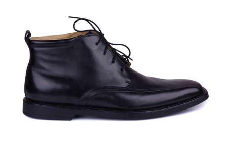 Black autumn boot on a white background Stock Photo