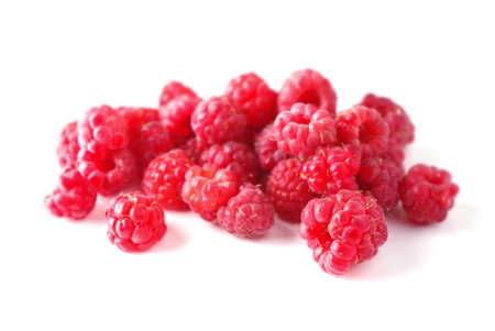 Group raspberries on a wite background