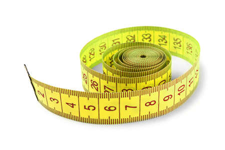 Rolled measuring tape on a white background Stock Photo