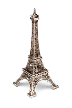 Eiffel tower figurine on a white background photo
