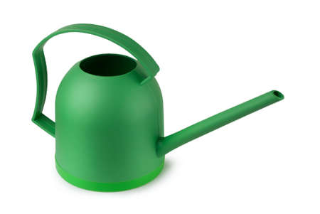 Green watering can on a white background