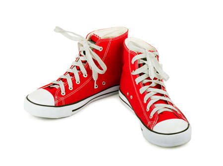 Red sneakers on a white background Stock Photo