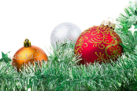 close up image: Balls and tinsel on a white background
