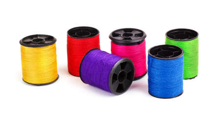 large group of items: Various thread spools on a white background
