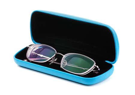 New glasses in a case on a white background