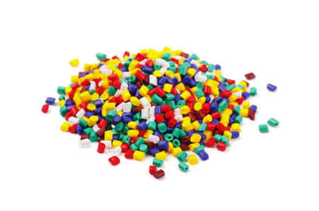 Colourful plastic granules on a white background Stok Fotoğraf