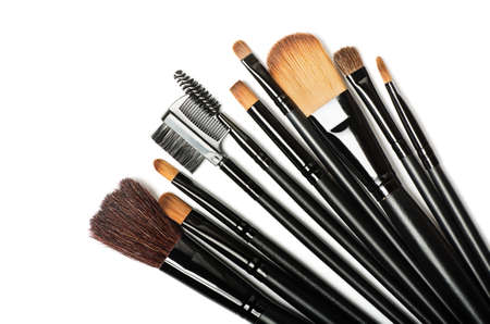 makeup fashion: Various makeup brushes isolated over white background