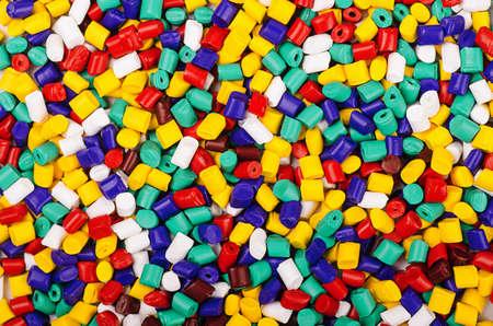 Fondo de colorido granulados plásticos industriales Foto de archivo - 40918117