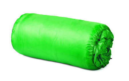 Rolled green camping bed isolated on white Stok Fotoğraf