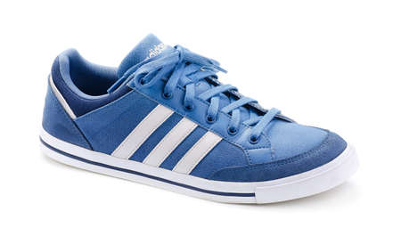 adidas: SAMARA, RUSSIA - June 8, 2015: Adidas Neo sneaker for running, football, training, in gray and blue, showing the Adidas logo and famous three stripes, illustrative editorial Editorial