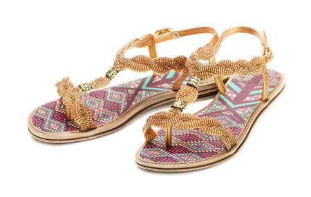 fetishes: Female sandals isolated on white background Stock Photo
